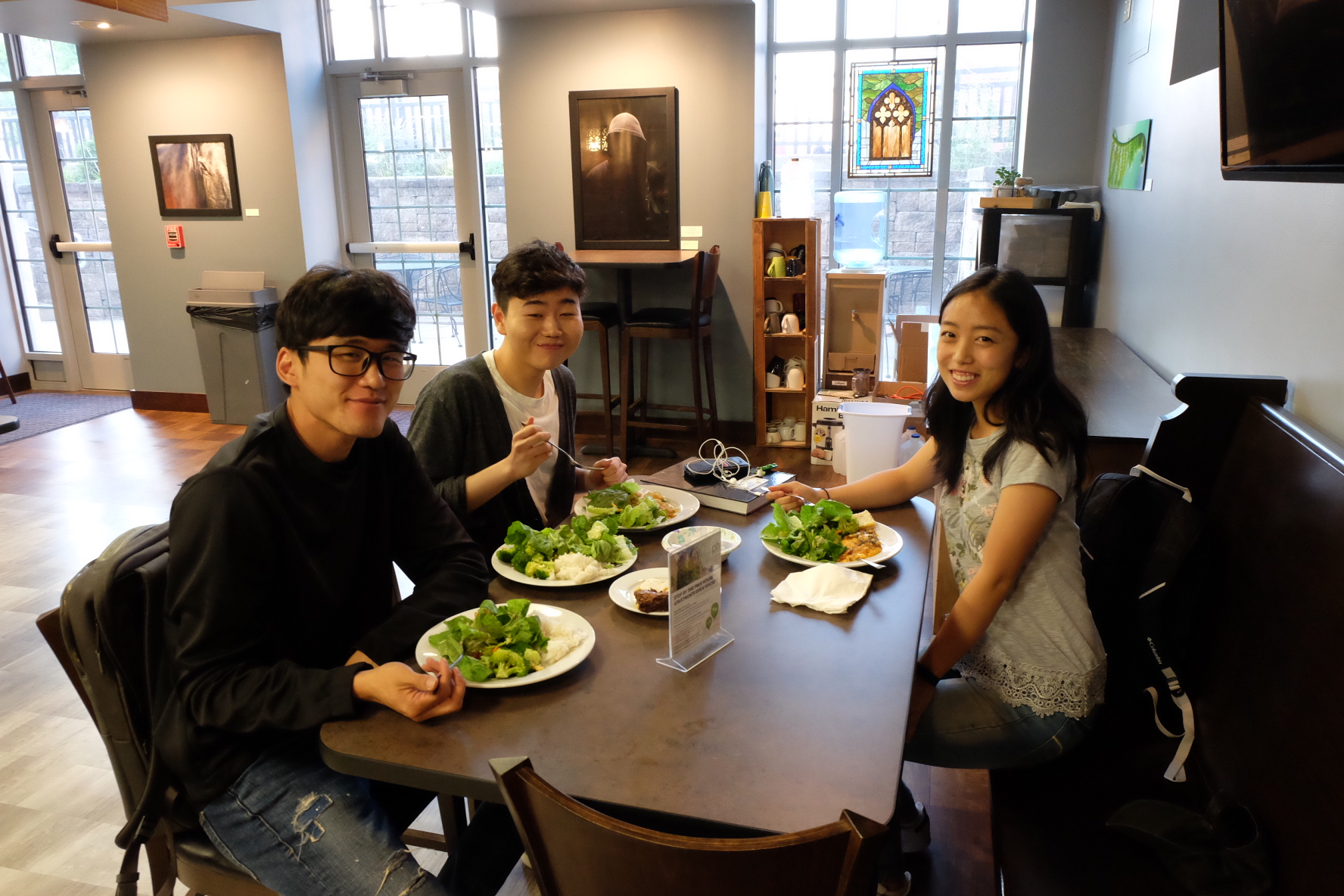 Three People Eating At Table
