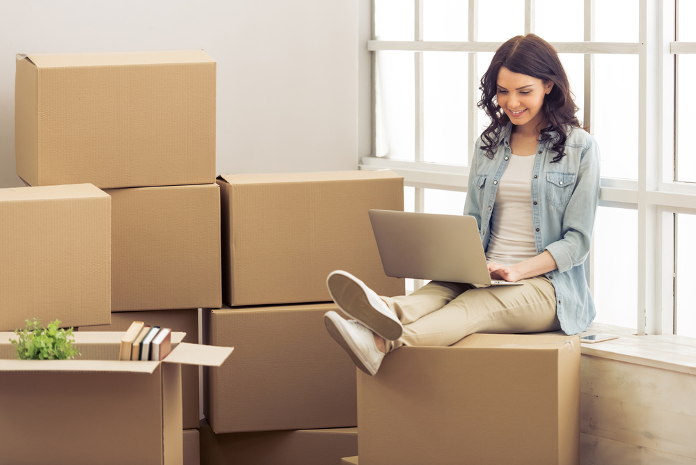 Young Adult Women Moving Boxes